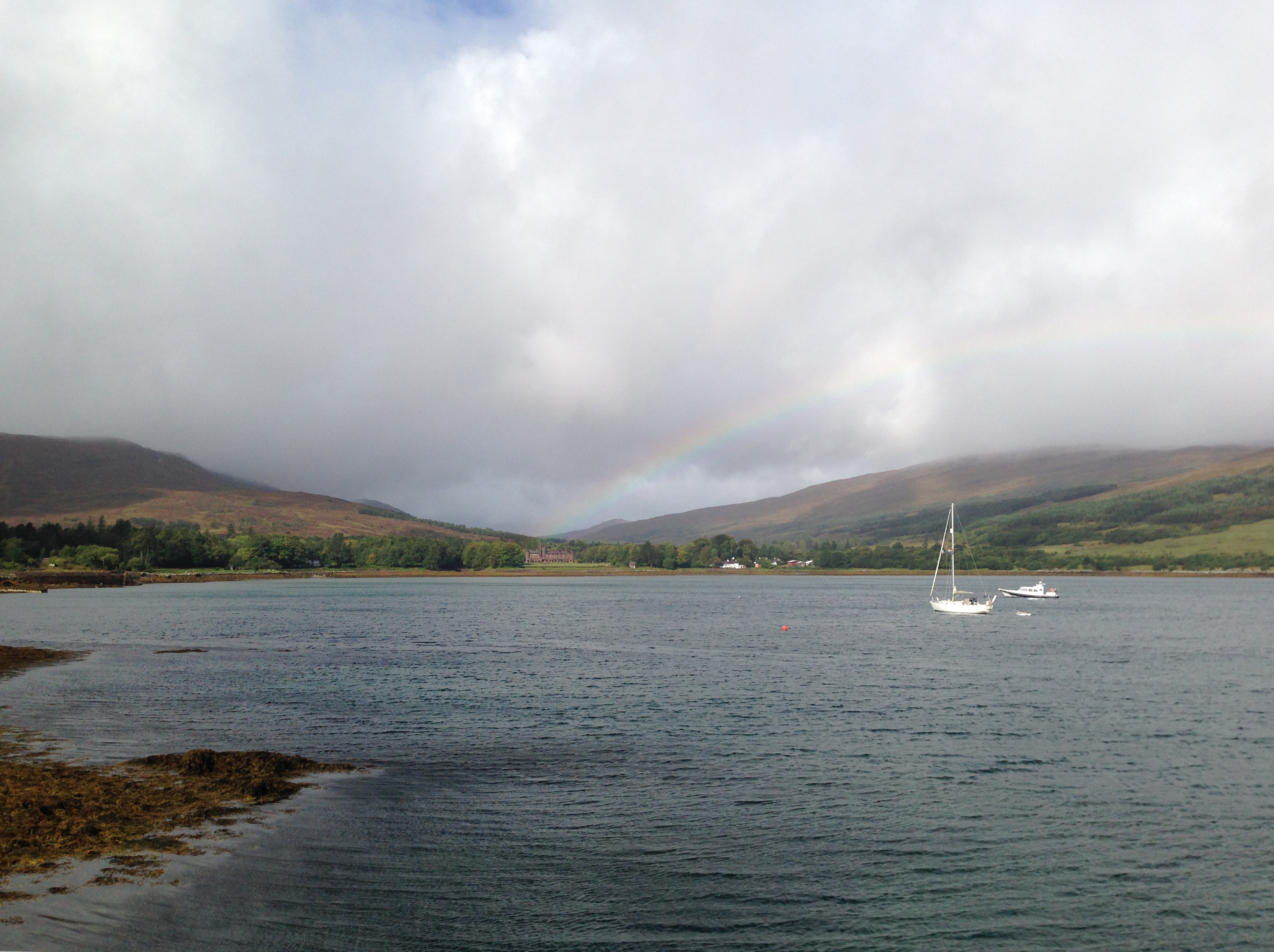 Kinloch Castle is just visible at the end of the rainbow
