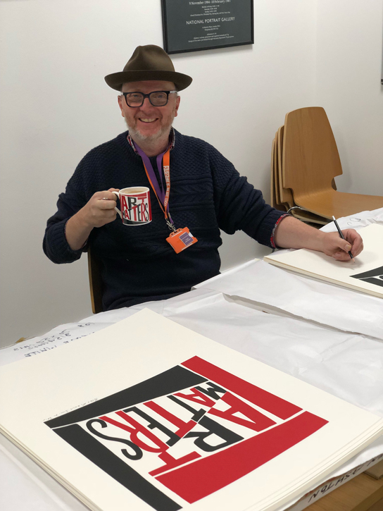 Bob and Roberta Smith signing the limited edition prints in the Art UK offices