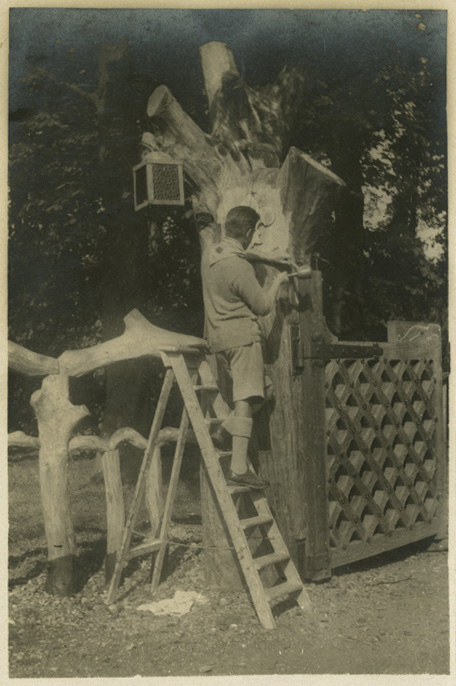 Don Potter carving the Leopard Gates at Gilwell Park