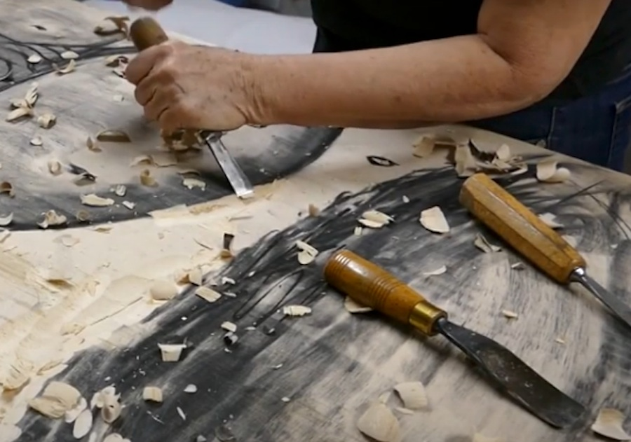 Christine Kowal Post demonstrating wood carving