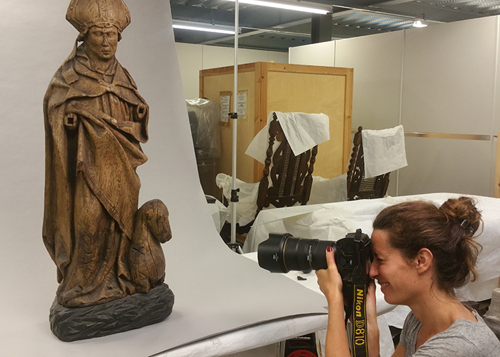 Photography Manager Jessie Maucor photographs sculpture at National Museums Scotland, Edinburgh