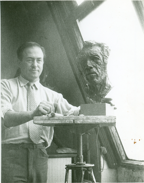 Alfred Cohen working on the bust of Anthony Quinn