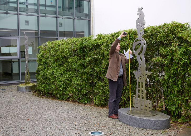 Coordinator Dickon Hall measuring a sculpture at University Hospital, Belfast