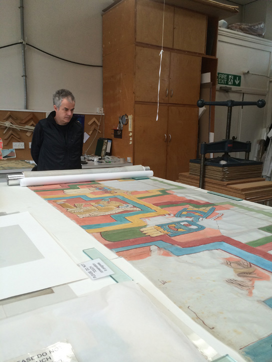 Photographer Dan Brown with one of Adela Breton's works, one section of the copy of the frieze on the Acancéh temple, laid out in the conservation studio