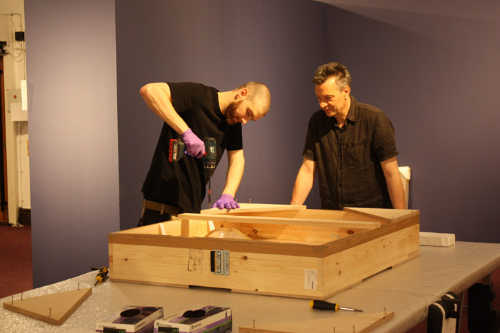 Dave Brunn, Museum Technician, and Peter Ogilvie, Collections Manager, unpacking a transit frame