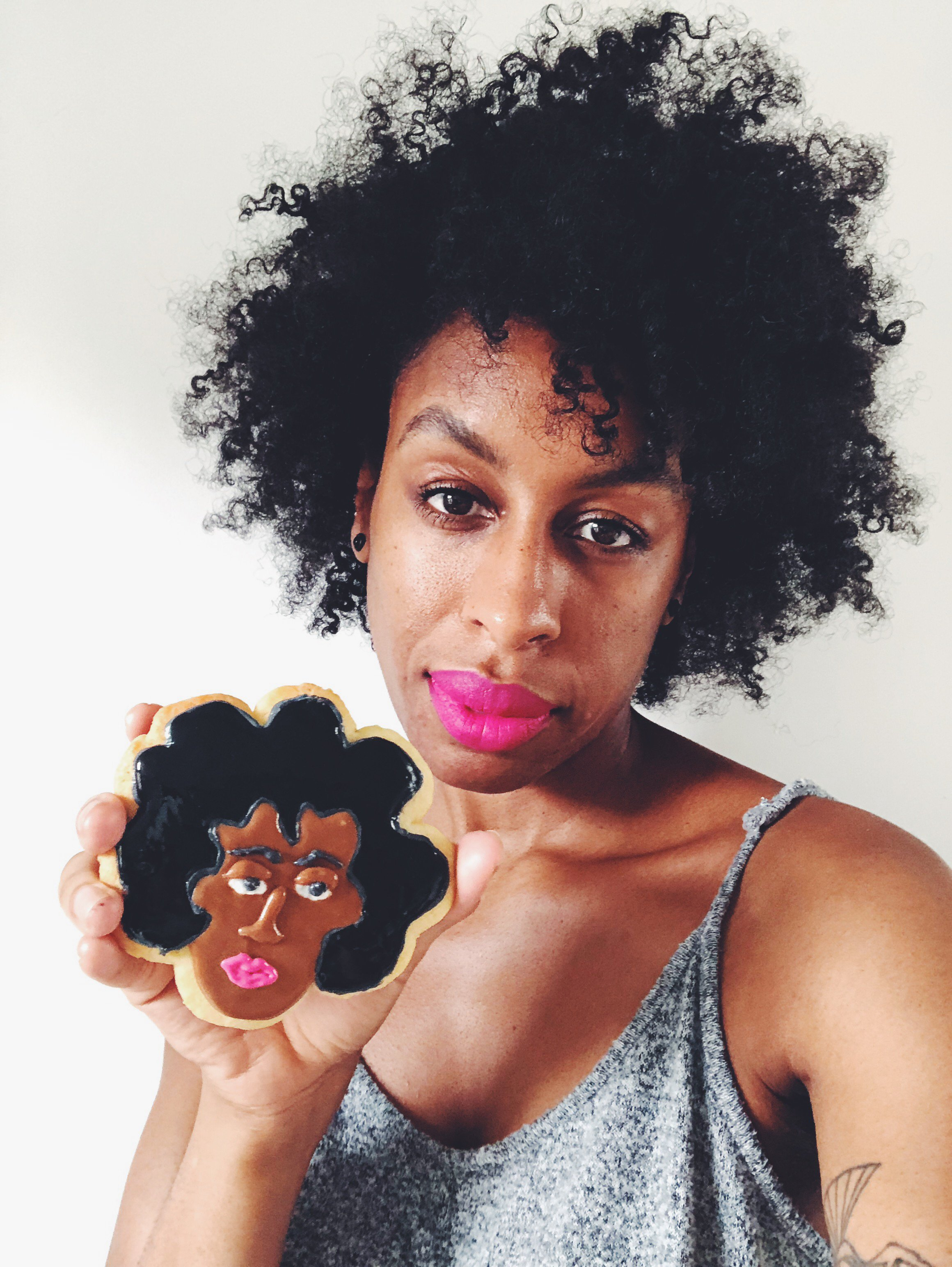 Art UK's very own Ferren Gipson and her self portrait in biscuit form
