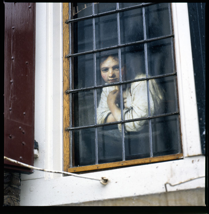 Girl-at-a-window-725px--1-.jpg