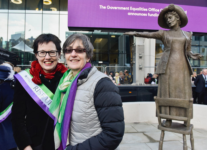 In front of the statue 'Rise Up Women', depicting Emmeline Pankhurst, St Peter's Square, Manchester, by Hazel Reeves, erected 2018