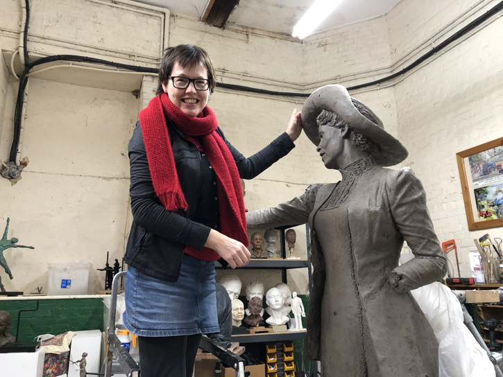 Hazel Reeves in her studio with the original clay model for her statue of Emmeline Pankhurst