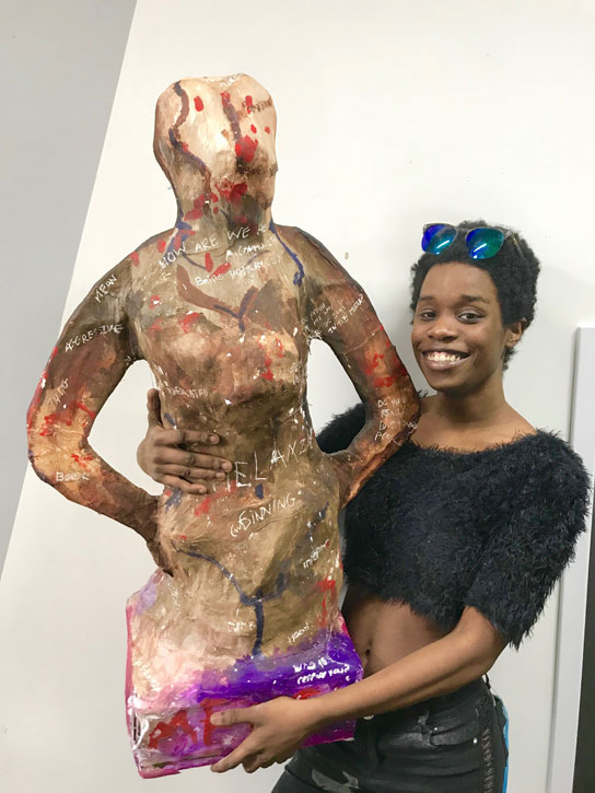 Participant with her finished sculpture