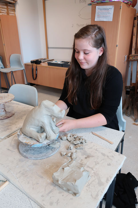 A pupil works with clay at a Masterpieces in Schools event