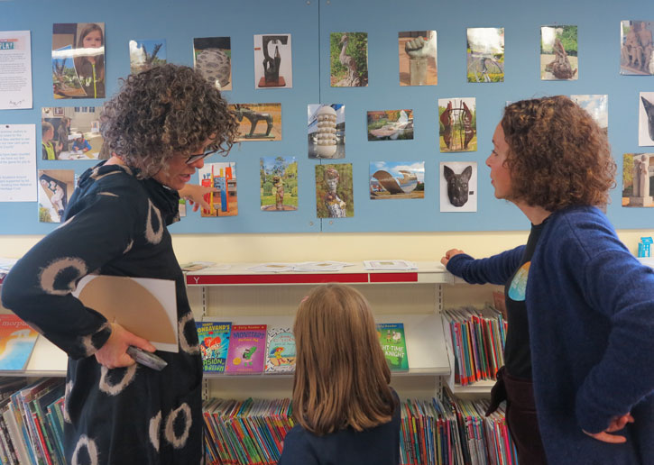 Artist Nicola Burrell discusses her work 'New Town' with a young participant and Selina Levinson Drake, Learning and Engagement Manager at Art UK