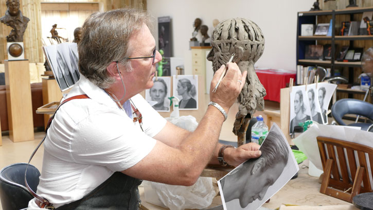Sculptor Andrew Sinclair at work