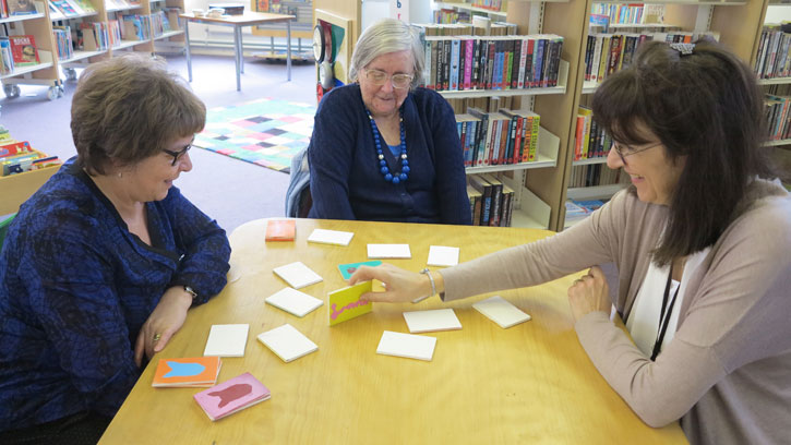 Invitation to Play games session at Tye Green Library, with cards made by the Brownies