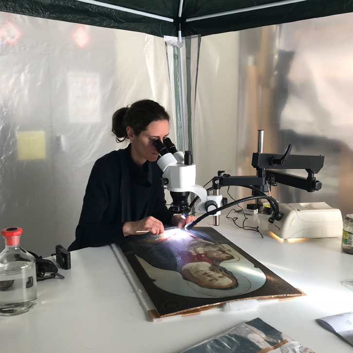 Treatment of the painting under the microscope