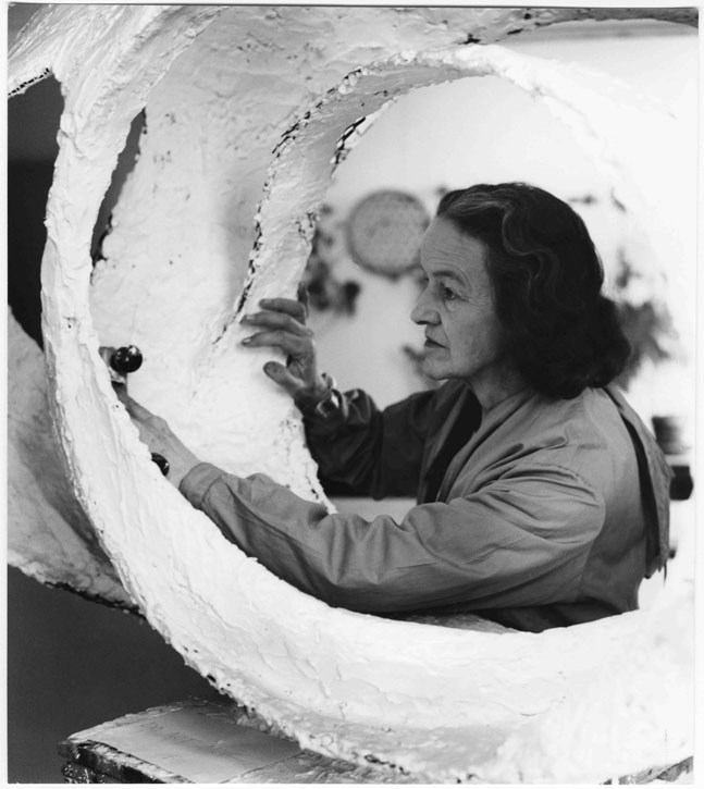 Barbara Hepworth at work on the plaster for 'Oval Form (Trezion)', 1963
