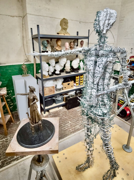 The maquette next to the full-size armature