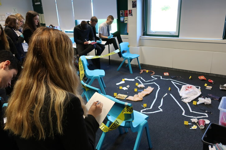 Students investigate their crime scene