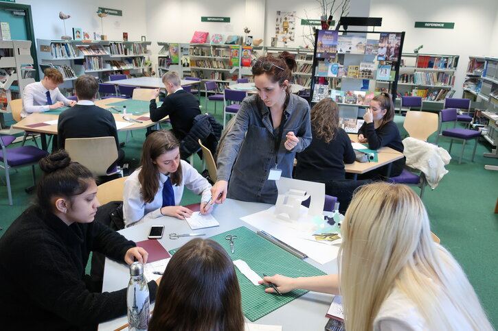 Lucy Roscoe leads students to create a pop-up paper sculpture