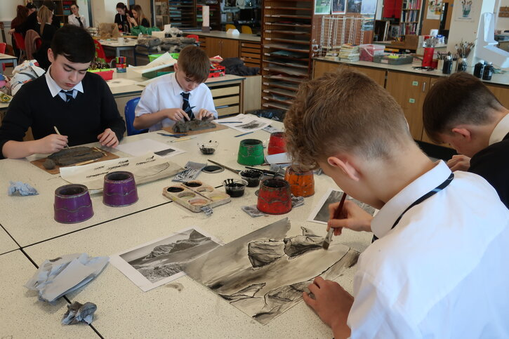 Elgin High School pupils using brush and ink to depict a landscape