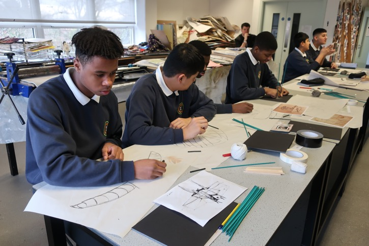 Jesmond Park Academy students sketch their ideas in charcoal