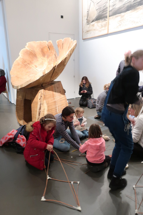 Families working amongst artwork in the Nash show