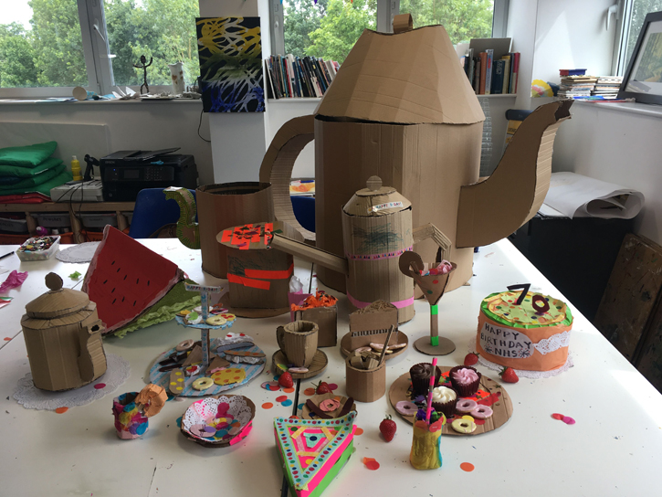 An intricate cardboard tea party installation made by families of NHS staff
