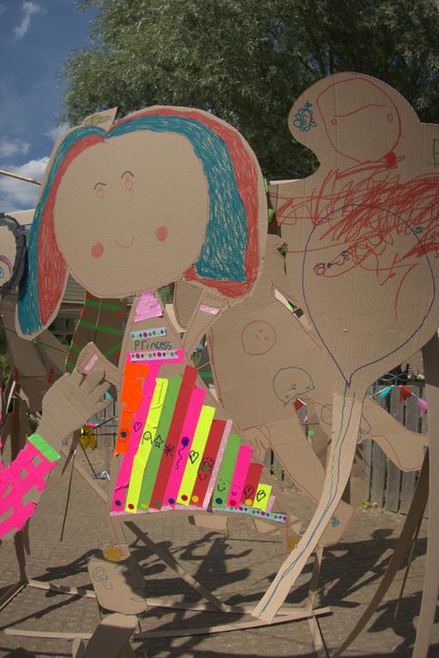 Joyful cardboard decorated figures make shadows in the sun!