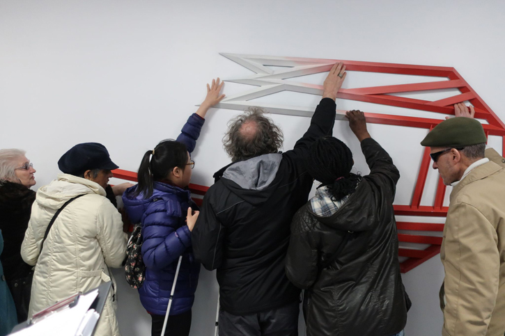 Participants explore sculpture at St George's Hospital, Tooting