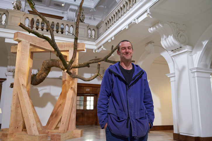 John Merrill with his sculpture