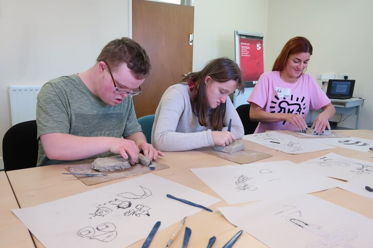 Tullie House's Community & Young Person Coordinator Lindsey Atkinson works along James Rennie pupils