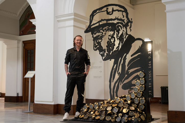 Nathan Wyburn with his sculpture