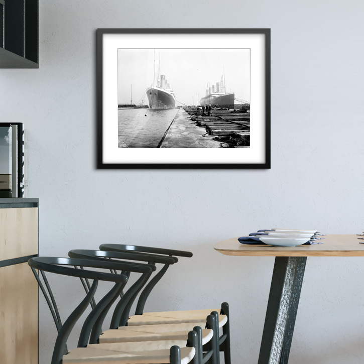 Framed print of 'Bow view entering Thompson Graving Dock with starboard bow view of 'Titanic'