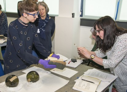 Jo bringing out First World War objects for delegates at creative symposium Doubtful Occasion