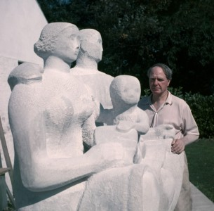 Henry Moore with 'Harlow Family Group', 1954–1955 (LH 364) outside the Top Studio, Perry Green