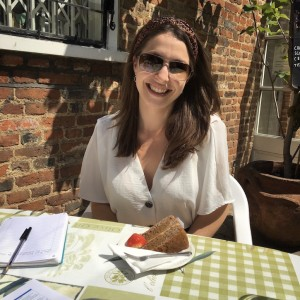 Gemma at Guildford House Gallery Café with a slice of coffee cake