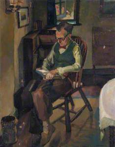 Man in Chair Reading