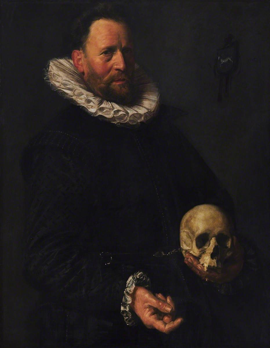 Portrait of a Man Holding a Skull
