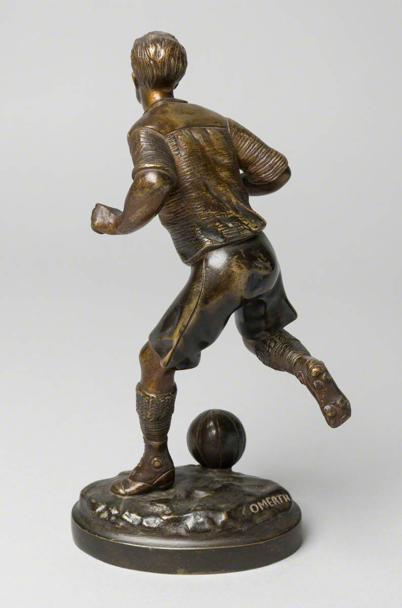 Footballer Running with the Ball