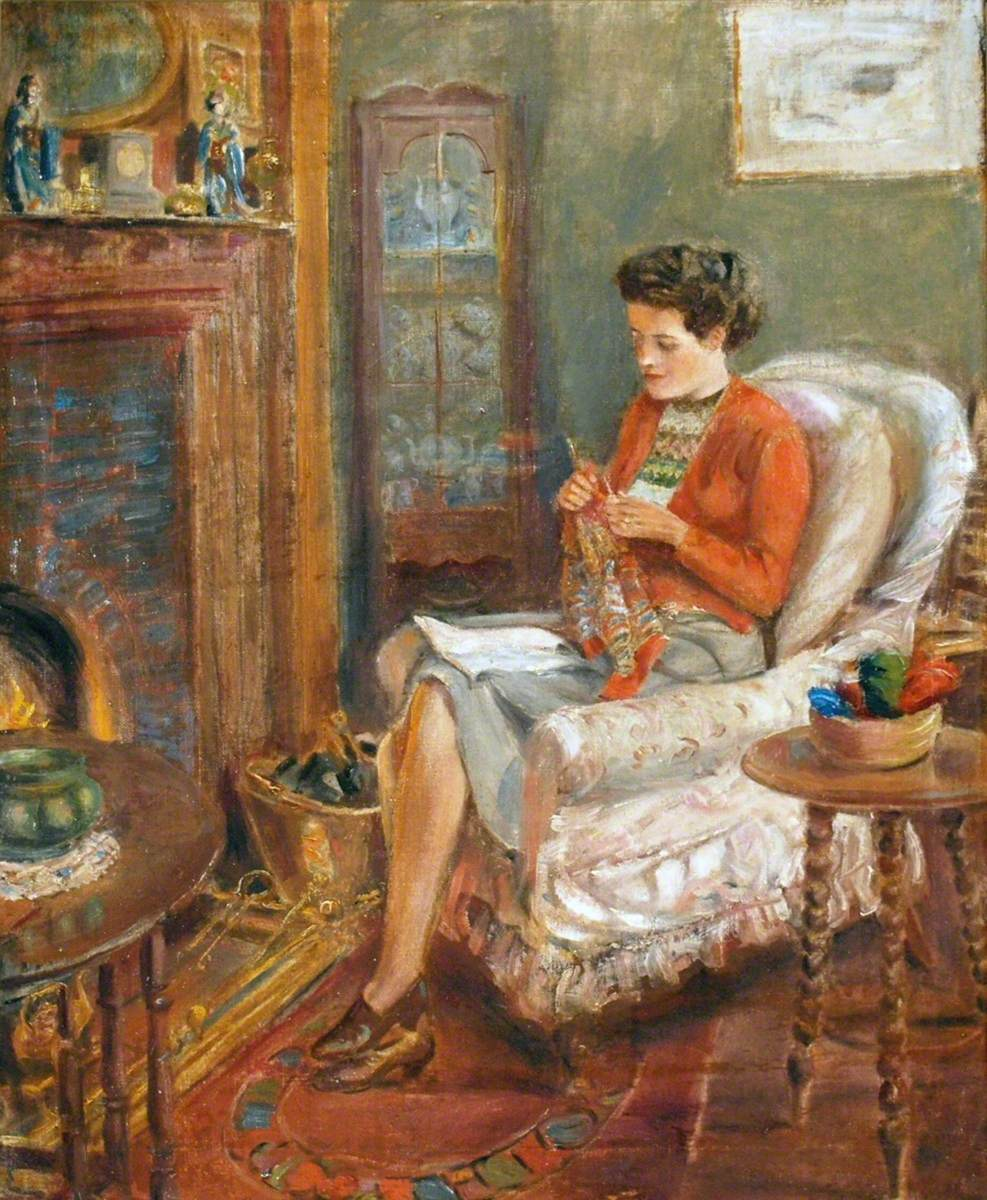 Irene Knitting in an Easy Chair