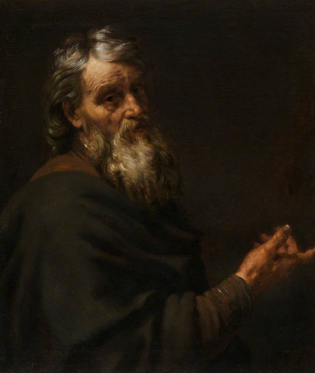 A Bearded Old Man Gesturing with His Right Hand