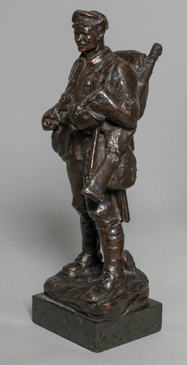Soldier Carrying a German Helmet