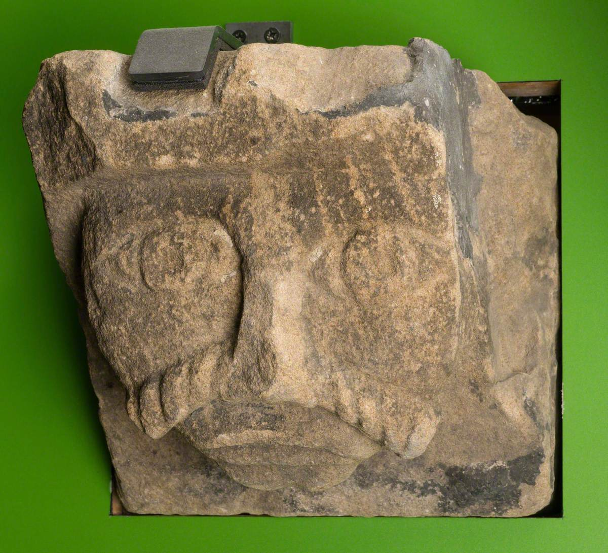 Sandstone Corbel in Form of Romanesque Human Head: Monk Bretton Priory