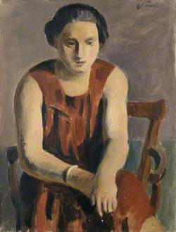 Seated Woman wearing a red Dress