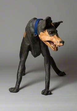 Brown and Black Dog with Blue Collar