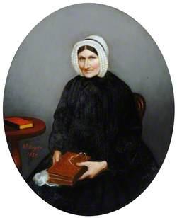 Portrait of a Woman Wearing a Black Dress and a Lace Bonnet