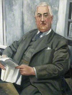 Portrait of a Man Reading a Paper