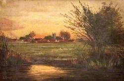 Houses and a Church near a River