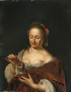A Lady Seated Holding a Small Dog