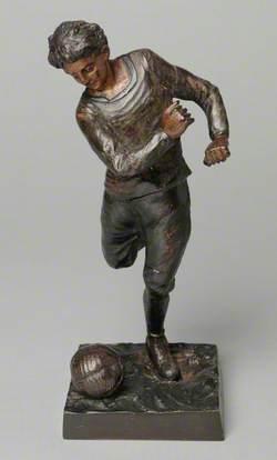 Boy Kicking a Football*